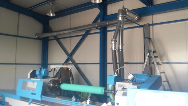 Dedusting of a lathe machine with special designed suction hoods
